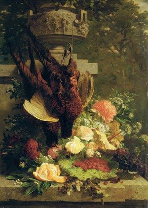 Hanging pheasants with summer flowers on a stone ledge in a garden