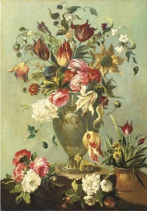 Flowers in a vase on a stone ledge