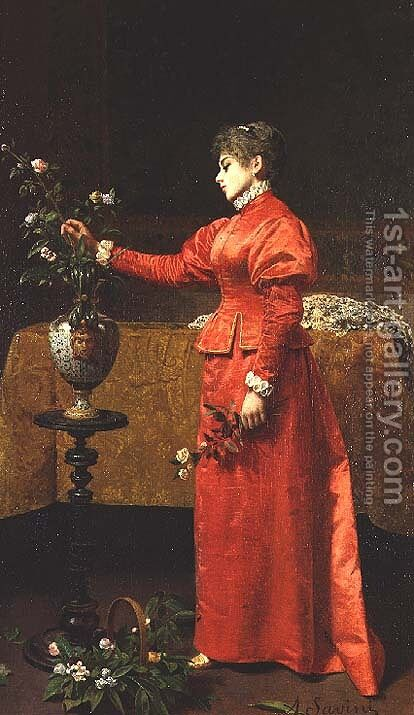 Woman arranging a vase of flowers by Alfonso Savini - Reproduction Oil Painting