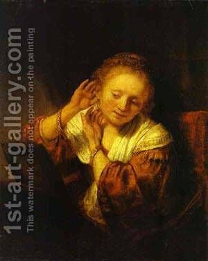 A Young Woman Trying On Earings 1657 by Harmenszoon van Rijn Rembrandt - Reproduction Oil Painting
