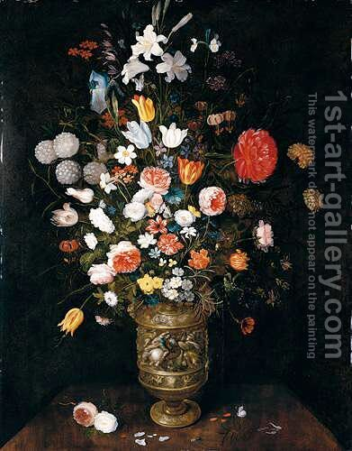 Still Life Of Roses, Daffodils, Carnations, Snake-Head Fritillaries, Irises And Lilies In A Sculpted Parcel-Gilt Vase, Upon A Stone Ledge by Jan, the Younger Brueghel - Reproduction Oil Painting