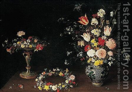 A Still Life Of Flowers In A Tazza, A Garland Of Flowers On A Table, And Roses, Tulips, Irises And Other Spring And Summer Flowers In A Wan-li Porcelain Vase, All On A Ledge by Jan, the Younger Brueghel - Reproduction Oil Painting
